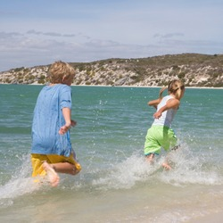 Two children playing in the sea