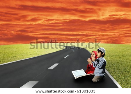 Two children sitting on road and reading