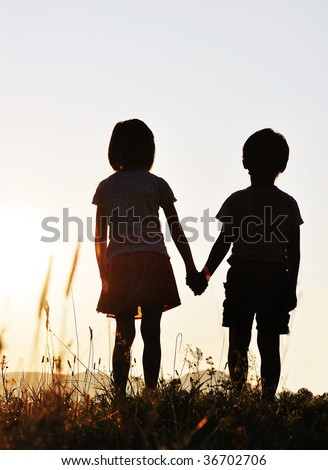 Two children, sunset, romantic scene
