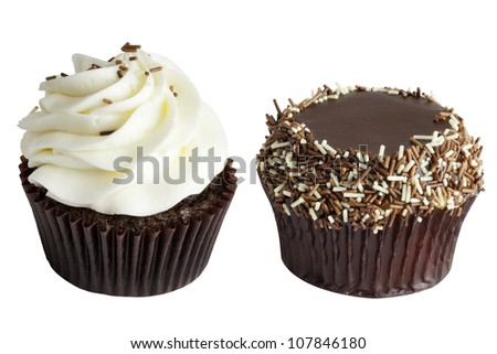 Two Chocolate Cupcakes, one cupcake with white chocolate icing and chocolate sprinkles, and the other cupcake with chocolate icing with chocolate sprinkles