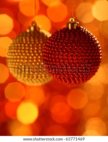 Two Christmas ball against blurred background