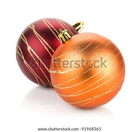 Two christmas balls: red and orange. Isolated on white background