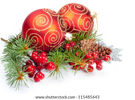 Two christmas balls with pine and decorations
