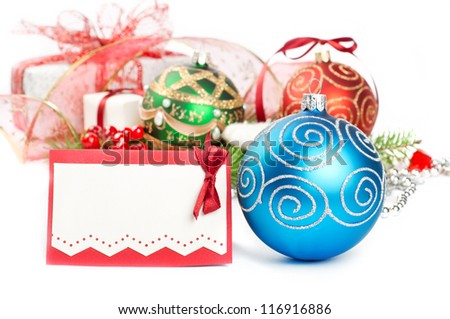 Two christmas balls with pine decoration
