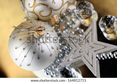 Two Christmas baubles, Cristal sphere and star golden background with reflections