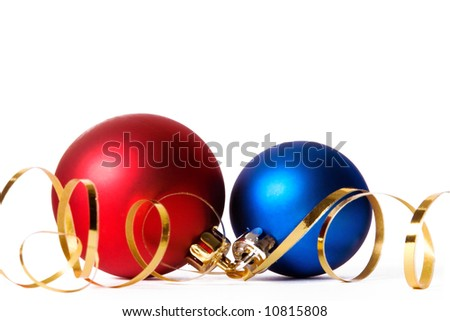 Two Christmas baubles with gold ribbon spirals