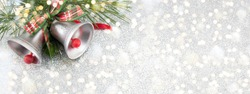 Two Christmas bells decoration with festive background
