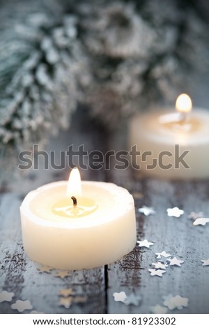 two christmas candles with decoration