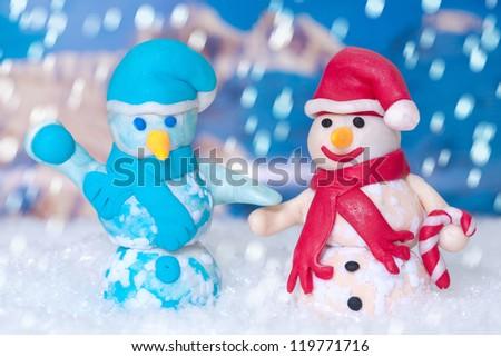 Two Christmas snowmen while wintertime