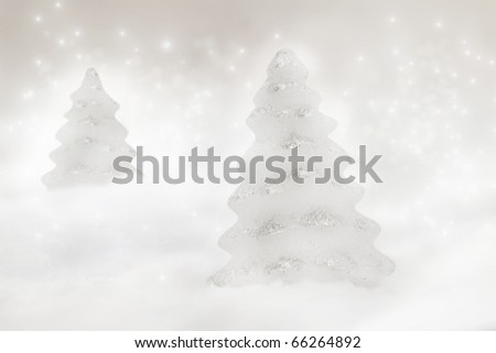 Two Christmas trees on bokeh background