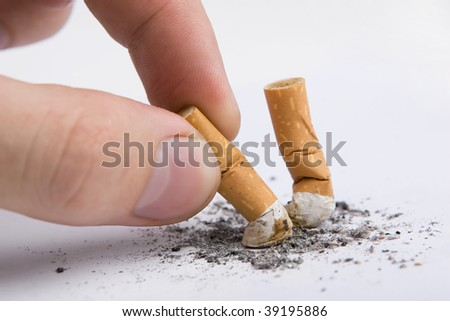 Two cigarettes butt in a hand on white