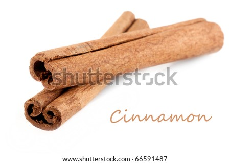 Two cinnamon sticks isolated on white background.
