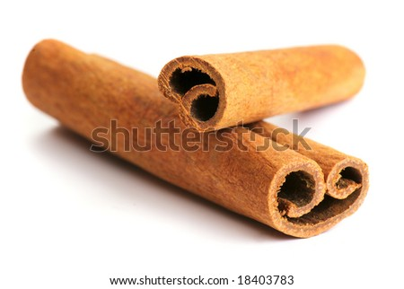 Two cinnamon sticks isolated on white background. Close up.