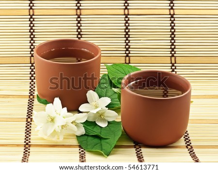 Two clay cups with jasmin green tea