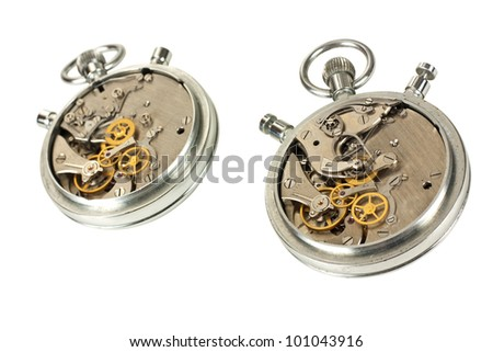 Two clock mechanisms isolated over white with clipping path