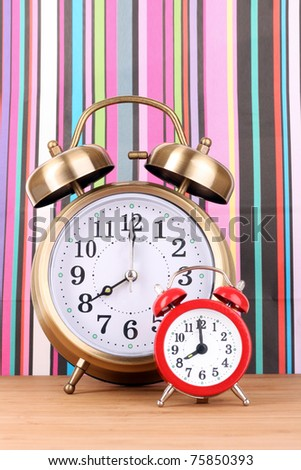 Two clocks    on  color background