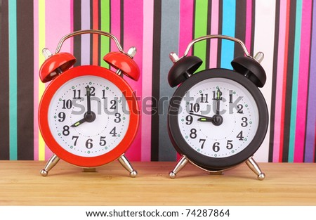 Two clocks    on  color lines background