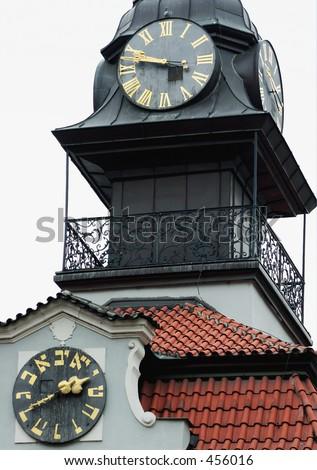 Two Clocks - One running back - Prague - Czech Republic -