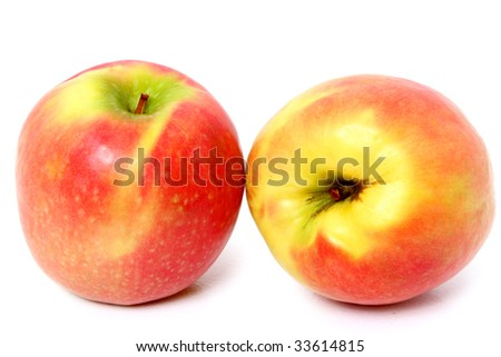Two close-ups of organically grown apples.