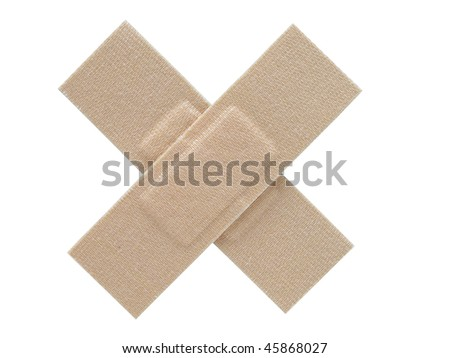Two cloth plasters placed together to form a cross. Isolated on a white background.