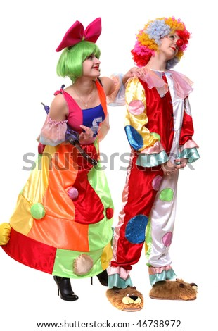 Two clown-girls in wigs and fancy costumes