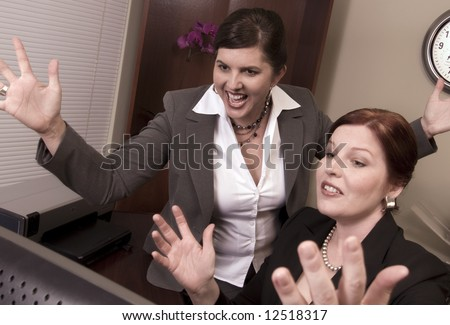 Two Co-Workers or Business Partners Celebrating Excellent News.