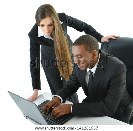 Two Co-Workers working on laptop