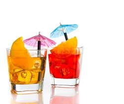 two cocktail with orange slice and umbrella on top isolated on white background with space for text