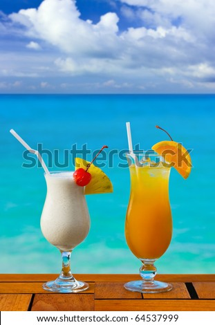 Two cocktails on table at beach cafe - vacation background