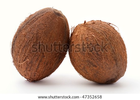 two coconuts isolated on white