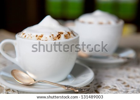 two coffee cups at the restaurant or cafe