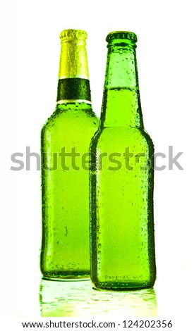 Two cold beers in green bottle isolated on white. Soft shadow St. Patrick's Day