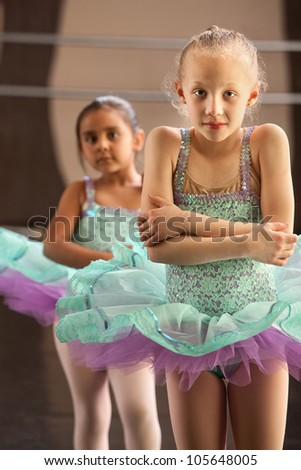 Two cold little children in ballet dresses