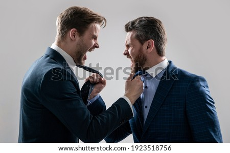 two colleagues have disagreement and conflict. businessmen face to face. disrespect and contradiction. business partners blame each other. arguing businesspeople. dissatisfied men discuss failure. ストックフォト ©