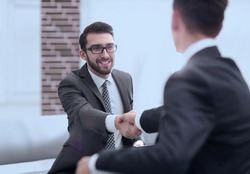 Two colleagues shaking hands after a business meeting