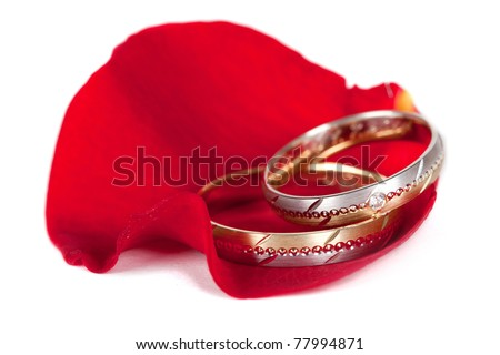 stock photo Two color gold and silver wedding rings on a red petal