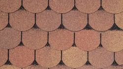 Two-color roof fragment grainy bituminous rooftop covering with pattern in form of elongated hexagons tiles of brown and green shades with black outline. Industrial construction background for design.