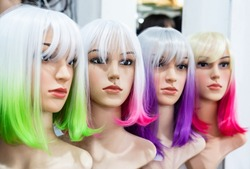 Two-color women's hair wig on the shelves in the wig shop.