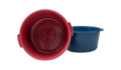 Two colored plastic basins on a white background for household chores