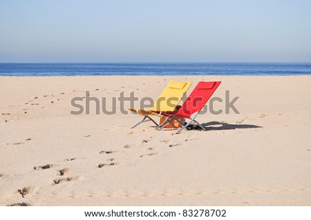 Two colorful beach chairs at the beach