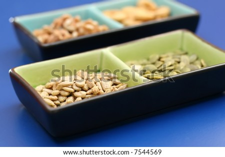 Two colorful bowls of healthy seeds and nuts