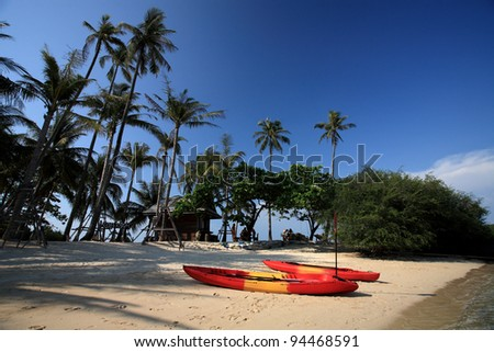 Two colorful canoe on sandy beach sea in Koh Kham of Koh Mak, Trad