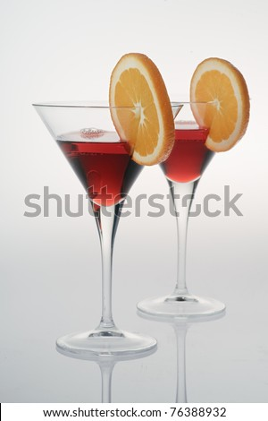 Two colorful drinks on white background