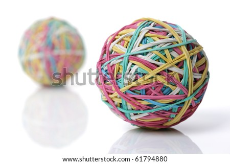 Two colorful rubber elastic band balls isolated on white