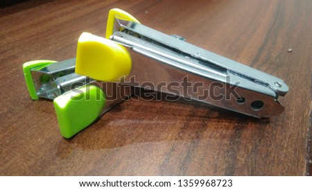 two colorful stapler