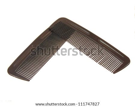 Two Combs on a White Background