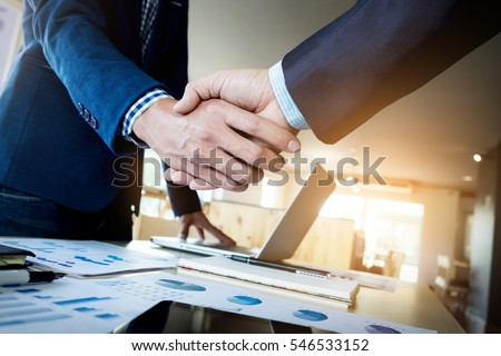 Two confident business man shaking hands during a meeting in the office, success, dealing, greeting and partner concept. Foto stock ©
