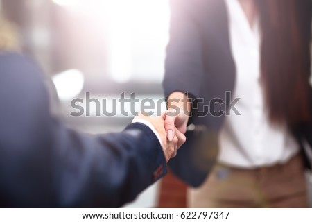 Two confident business man shaking hands during a meeting in the office, success, dealing, greeting and partner concept. #622797347