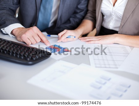 Two confident business people in the office at the meeting - stock photo