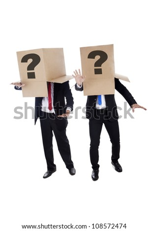 Two confused businessmen with question mark on the cardboard finding the way